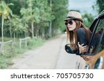 happy young woman looking out... | Shutterstock . vector #705705730