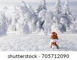 snowman traveler on a snowy... | Shutterstock . vector #705712090