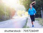 urban woman jogger running by...   Shutterstock . vector #705726049