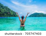 backside woman in bikini... | Shutterstock . vector #705747403
