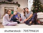 happy kids in pajamas holding... | Shutterstock . vector #705794614