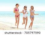 beautiful young women at sea... | Shutterstock . vector #705797590