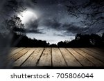 Wooden Table With Dark Sky And...