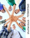 young people putting hands... | Shutterstock . vector #705809560
