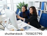 smiling filipino business women ... | Shutterstock . vector #705825790