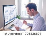 trader analyzing financial... | Shutterstock . vector #705826879