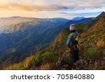 a traveler on top of mountain ... | Shutterstock . vector #705840880