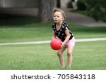a little girl is playing a game ... | Shutterstock . vector #705843118