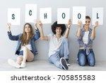 students holding school written ...   Shutterstock . vector #705855583