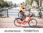 Young Beautiful Woman Riding A...