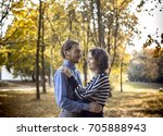 couple walking in the park ... | Shutterstock . vector #705888943