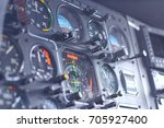device in the pilot cockpit | Shutterstock . vector #705927400