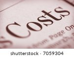 "Shallow depth of field with ""Costs"" and paper texture in focus. - stock photo"