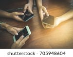 the hands of three people are... | Shutterstock . vector #705948604