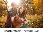 young couple sitting on bicycle ... | Shutterstock . vector #706001260