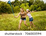 mom and daughter playing... | Shutterstock . vector #706003594
