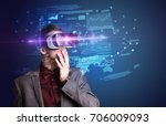 amazed businessman with virtual ... | Shutterstock . vector #706009093