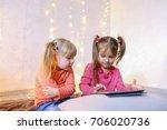 cute little girls play in...   Shutterstock . vector #706020736