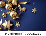 gold christmas ornaments on... | Shutterstock . vector #706021216