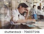 shot of stressed asian... | Shutterstock . vector #706037146