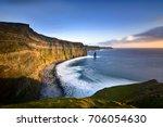 cliffs of moher at sunset  ... | Shutterstock . vector #706054630