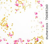 Stock photo mock up frame made of pink rose petals and golden confetti on white background flat lay top view 706085260