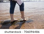 close up of girl's feet in the... | Shutterstock . vector #706096486