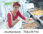 Stock photo buffet female worker servicing food in cafeteria 706135753