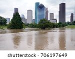 The consequences of the spill Buffalo Bayou River in Houston. Flooded park on Downtown city background. Hurricane Harvey