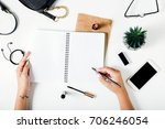 woman hands writing in a... | Shutterstock . vector #706246054