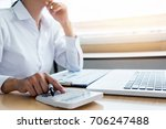 female accountant calculations... | Shutterstock . vector #706247488