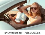young couple traveling by car | Shutterstock . vector #706300186
