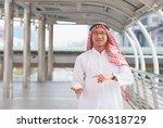 portrait of arab man and  raise ... | Shutterstock . vector #706318729