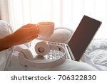 male sitting on white bed... | Shutterstock . vector #706322830
