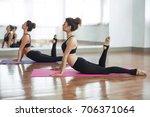 women doing yoga    Shutterstock . vector #706371064