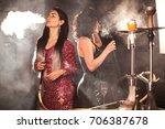 charming girls smoking hookah... | Shutterstock . vector #706387678