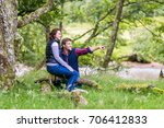 couple in highlands mountains... | Shutterstock . vector #706412833