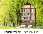 man made insect hotel in a... | Shutterstock . vector #706442149