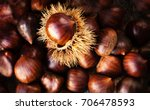 Ripe Chestnuts On Old Wooden...