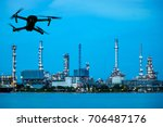 drone with camera flying on oil ... | Shutterstock . vector #706487176