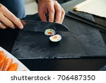 sushi being cut on a board   Shutterstock . vector #706487350