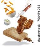grilled t bone steak floating... | Shutterstock . vector #706496053