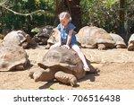 little girl riding a turtle.... | Shutterstock . vector #706516438