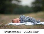 newborn baby in stripy romper...   Shutterstock . vector #706516804