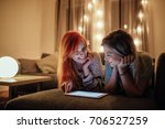 two young girls using tablet... | Shutterstock . vector #706527259