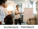 businesswoman explaining graph... | Shutterstock . vector #706538623