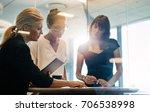 three businesswomen standing at ...   Shutterstock . vector #706538998