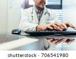 closeup of hands of male doctor ... | Shutterstock . vector #706541980