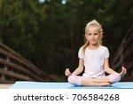 little girl doing fitness... | Shutterstock . vector #706584268