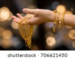 woman hand hold gold bracelet... | Shutterstock . vector #706621450